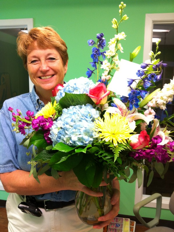 Glenda gets flowers from one of our guests!