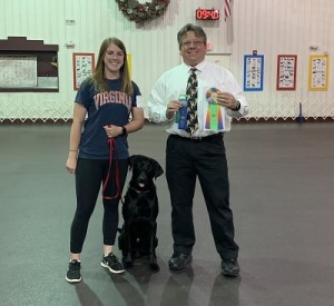 Professional Dog Trainer, McKenzie with her obedience title-winning pup, Gus!